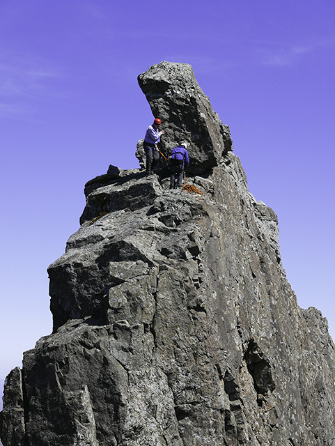 76_Neill preparing to abseil off the Inn Pinn.jpg