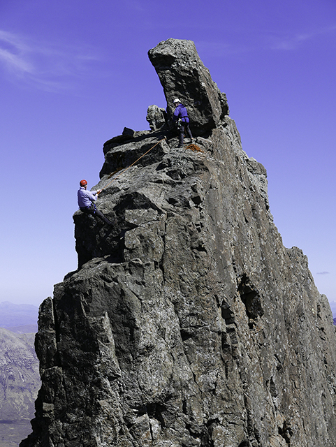 77_Neill abseilling off the Inn Pinn_2.jpg