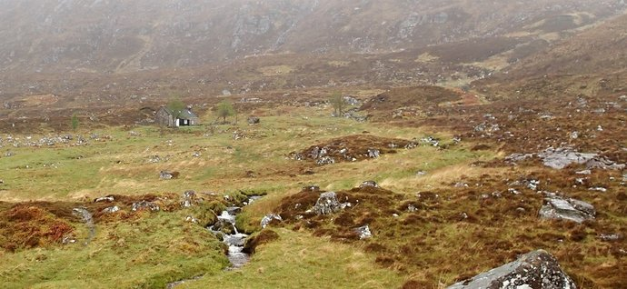 26 Leaving Shenavall bothy on a grey and grimm morning.JPG
