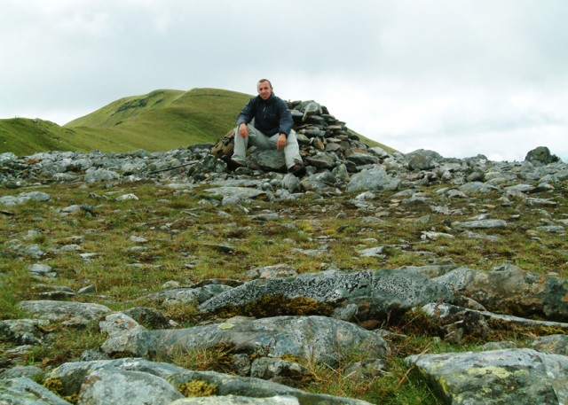 09 Me at the Cairn at Coire Liath with Meall Corranaich in background.JPG