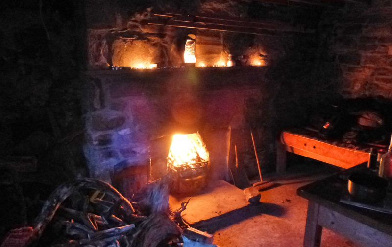 Bog wood warming the bothy