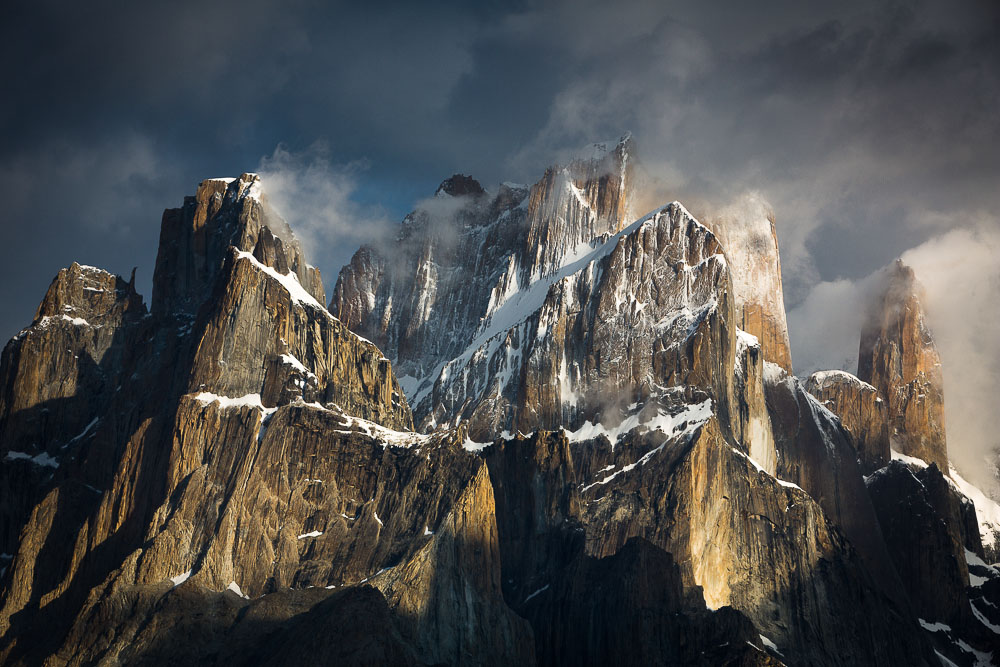 Trango Towers, Baltoro Glacier, Karakoram Mountains The above image was shot at dawn as the sun momentarily broke through the clouds and illuminated the vertical faces. It's a landscape, rising out of Tolkien mythology and yet as real and as primeval as the emerging Earth. Few places in the world can evoke the imagination in the way that the mountains of the Karakoram can and it is my ambition to capture some of their unique magic.