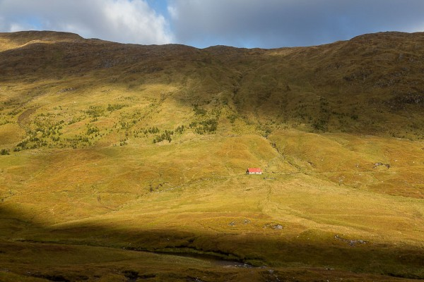 Camban Bothy. It's unlikely that the original building was a shieling, being too high and too remote. Instead, it was probably built to house a shepherd caring for flocks imported after the clearances, and was sited on the cattle drover's road from Skye.
