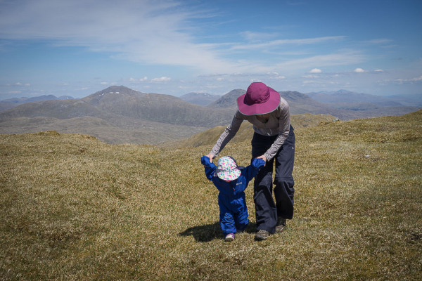 Getting some exercise out of the baby carrier, on the grassy summit of Beinn Bhuide